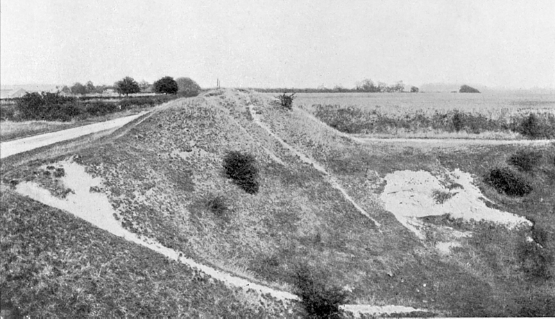 Known to generations of Letchworth children as the 'Roman Camp', this disused gravel pit was cut into a hillfort a thousand years earlier than Roman times. It is now overgrown with bushes.
