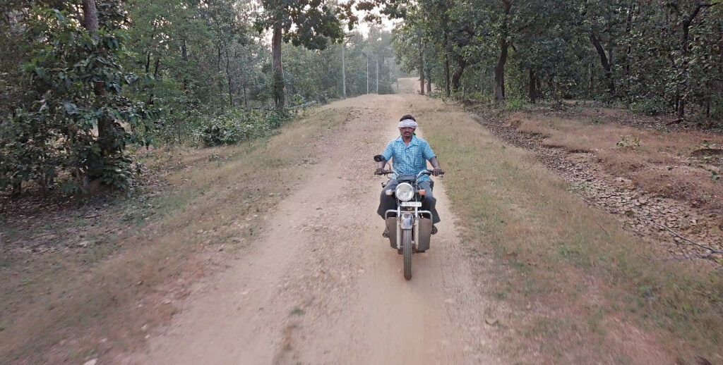 villager riding bike in Bastar, Chattisgarh