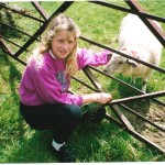 A young Jo with baby lamb