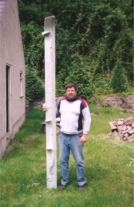 The writer with the large aluminium spar that was collected first. It measures 3m long by 18cm wide by 13mm thick.