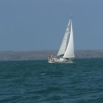 Another yacht with Skomer Island in the background.