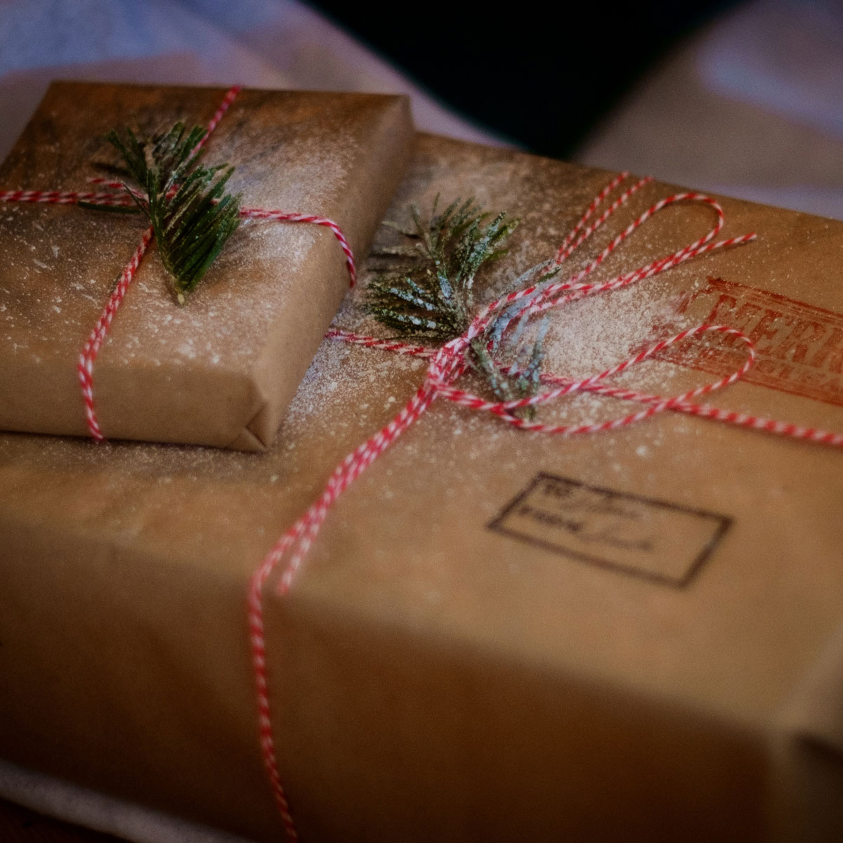 brown paper wrapped parcels with red ribbon