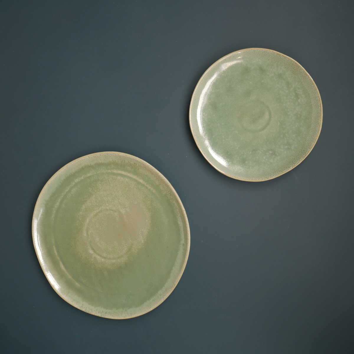 green-glazed-plate-&-side-plate-on-blue-background