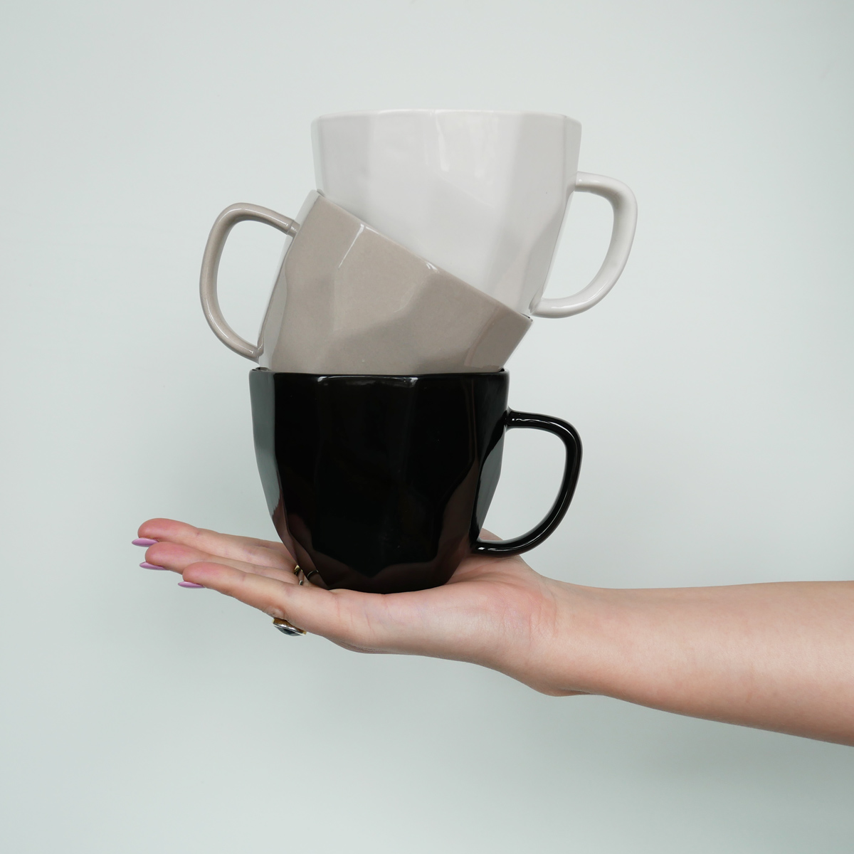 liv-interior-geometric-mug-hand-held-stack-black-on-grey-on-white