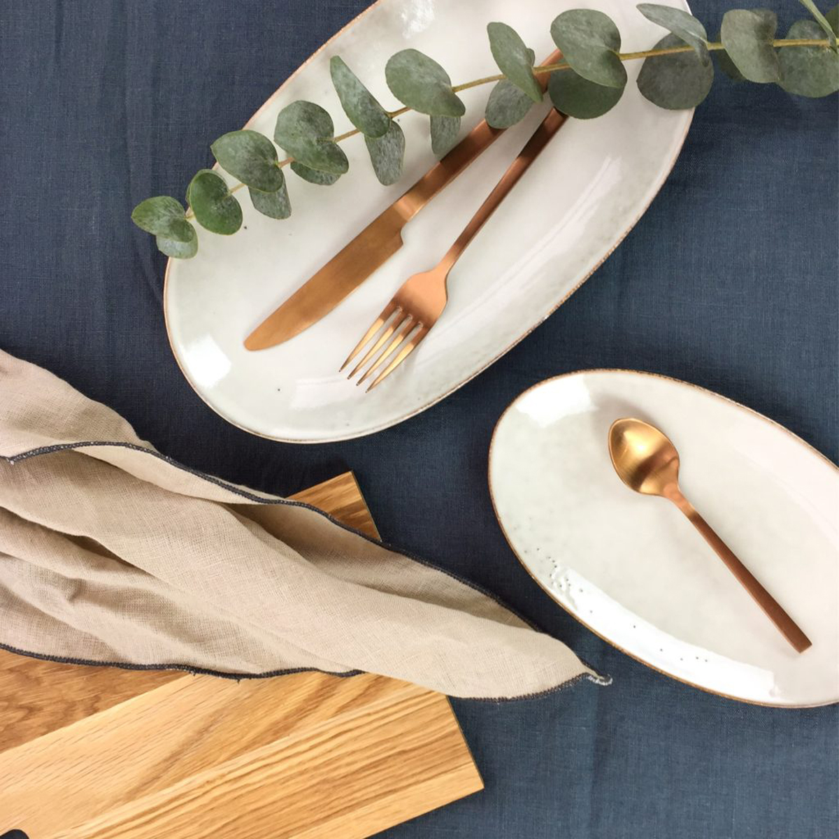 nordic sand oval plate on blue table cloth