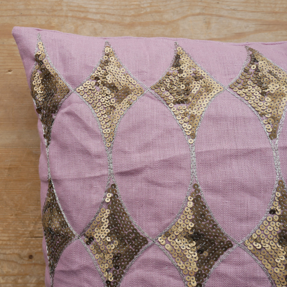 Rose-Sequin-Cushion-on-wood-lifestyle-image