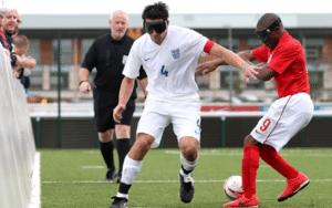 Keryn Seal, England Captain, holds off Darren Harris