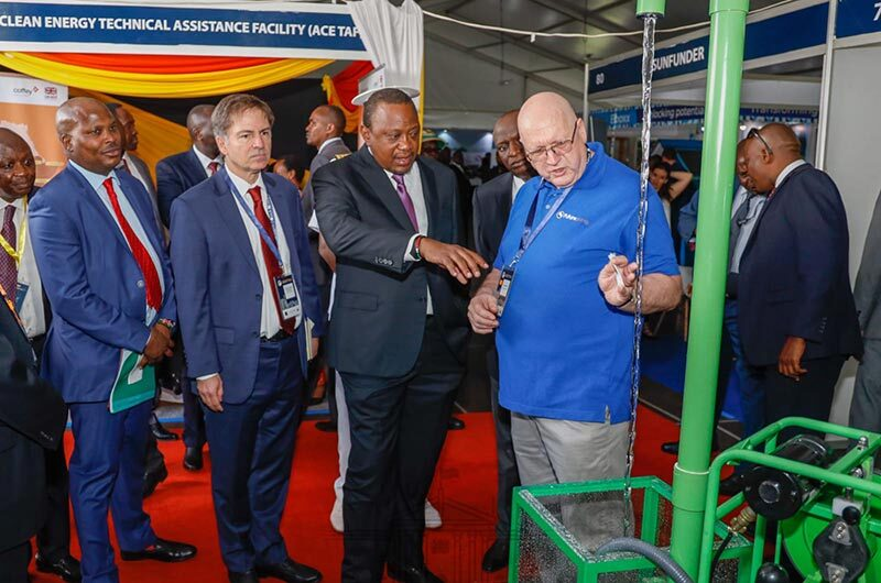 Solar irrigation partner, Futurepump, with their water pump and President Kenyatta