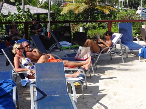 3 members of the Mines family relaxing at the pool in the Capella Hotel at the Marina in Marigot Bay