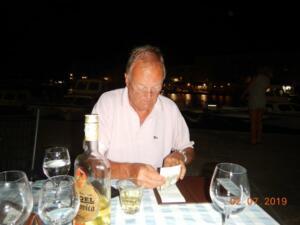 Bob struggling with the bill after copious Slivovitz