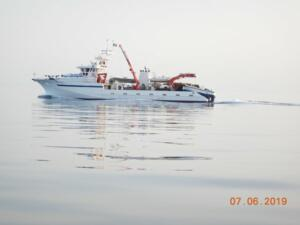 One of the many fishing vessels
