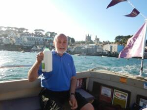 Richard with the essential milk on the ferry in Fowey