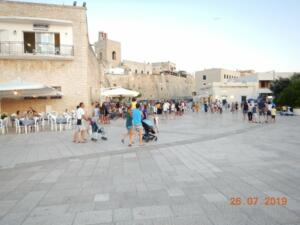 The walls of Otranto on a busy Friday evening