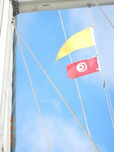 The yellow 'Q' flag denoting new arrival from another country with the Tunisian courtesy flag underneath