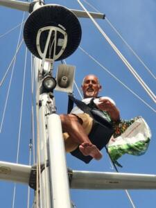 Walter up the mast in the bosuns chair. The birds had flown off at his approach - can't blame them for that!