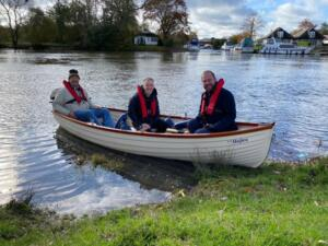 Two carers taking a senile old git out for the day in the 'sunshine boat'.