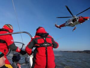 m_Helicopter preparing to winch crew onto Hejira's deck