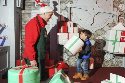 Ronan Abrahams (3) at the present sorting station. Santa's Secret Workshop Grotto at the intu Trafford Centre. *** Local Caption *** Disclaimer: While Cavendish Press (Manchester) Ltd uses its' best endeavours to establish the copyright and authenticity of all pictures supplied, it accepts no liability for any damage, loss or legal action caused by the use of images supplied. The publication of images is solely at your discretion. For terms and conditions see http://cavendish-press.co.uk/pageserms.aspx