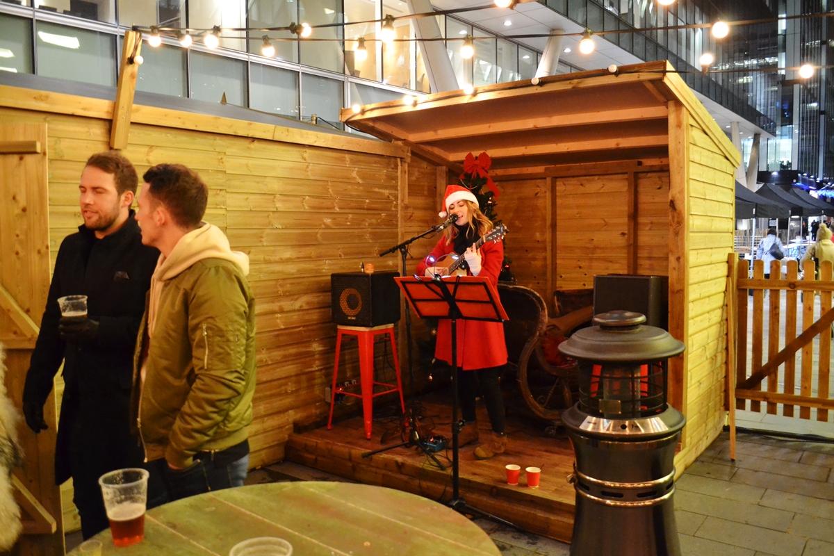 Bar Hutte returns to Manchester Spinningfields Christmas Markets singer
