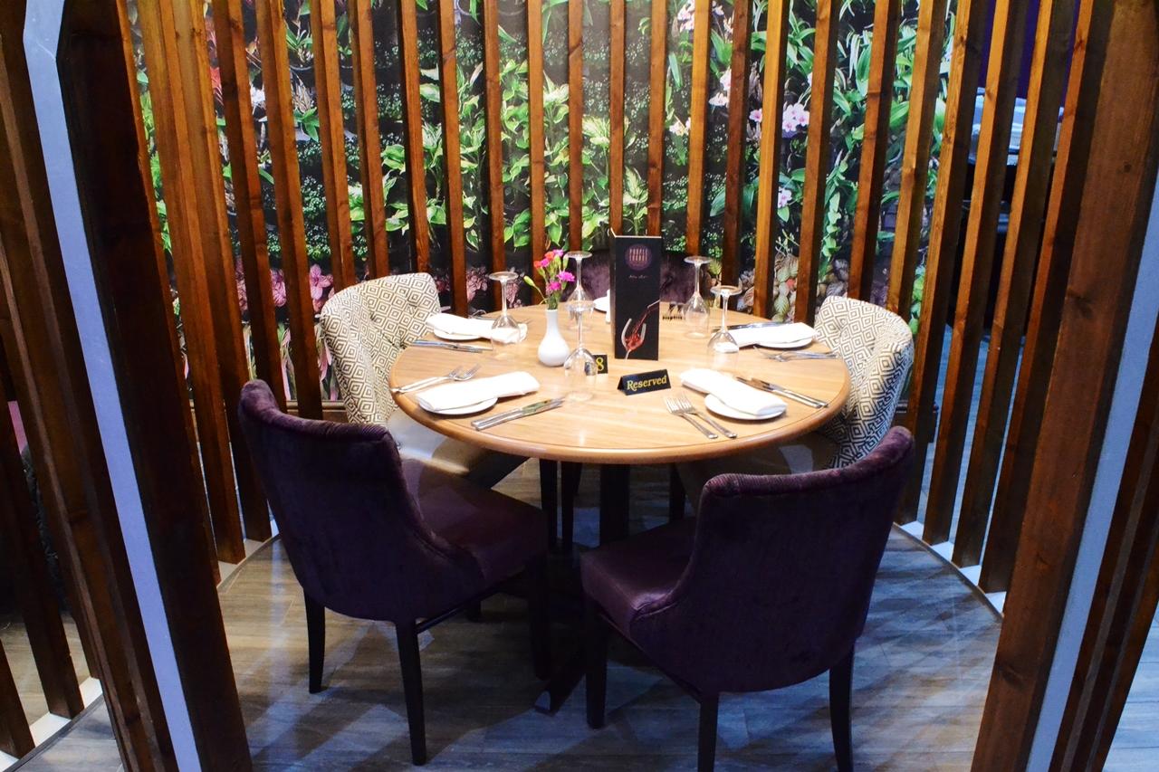 Dining Pods purple lounge wooden walkden