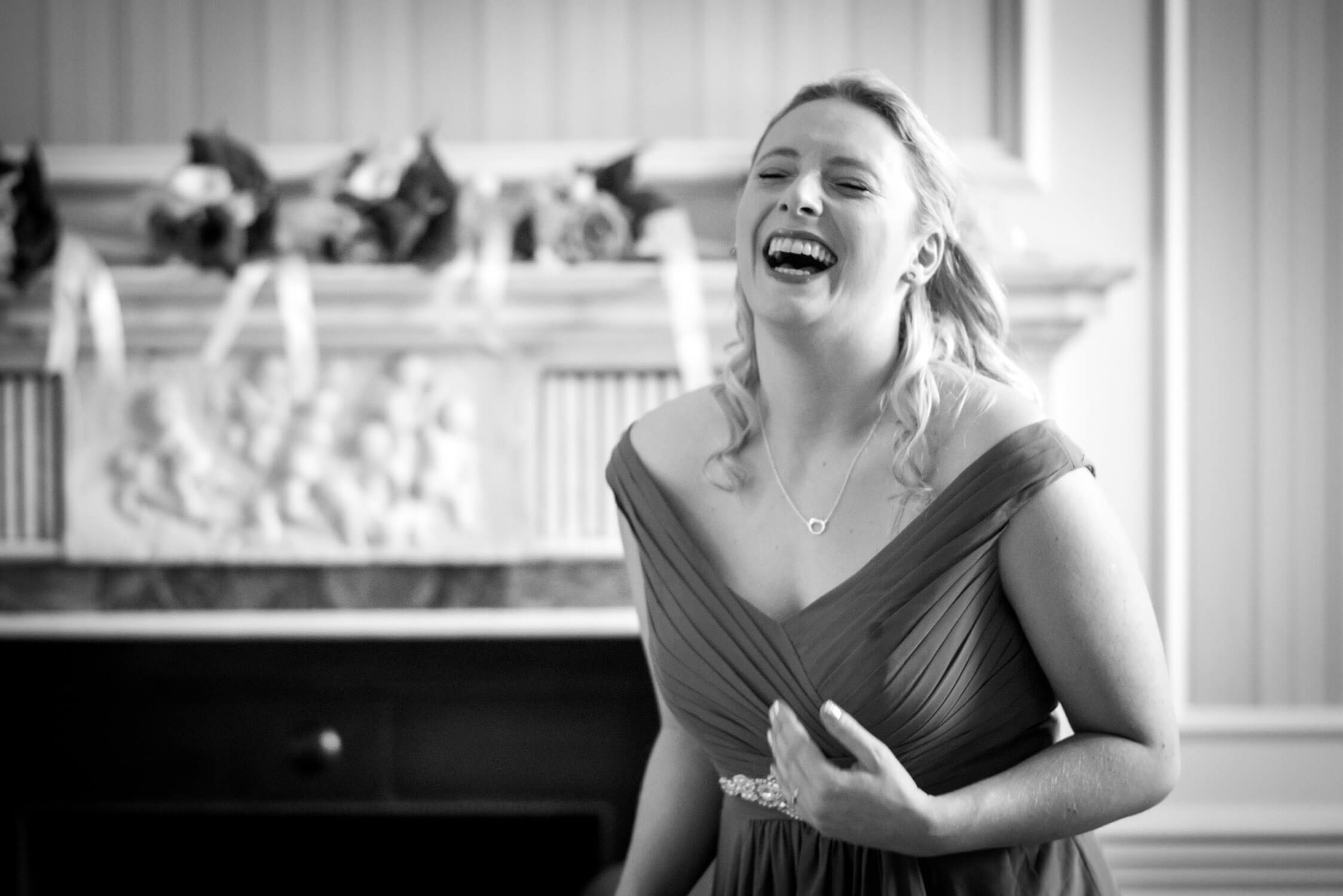 Maid of honour at Tylney Hall has a giggle
