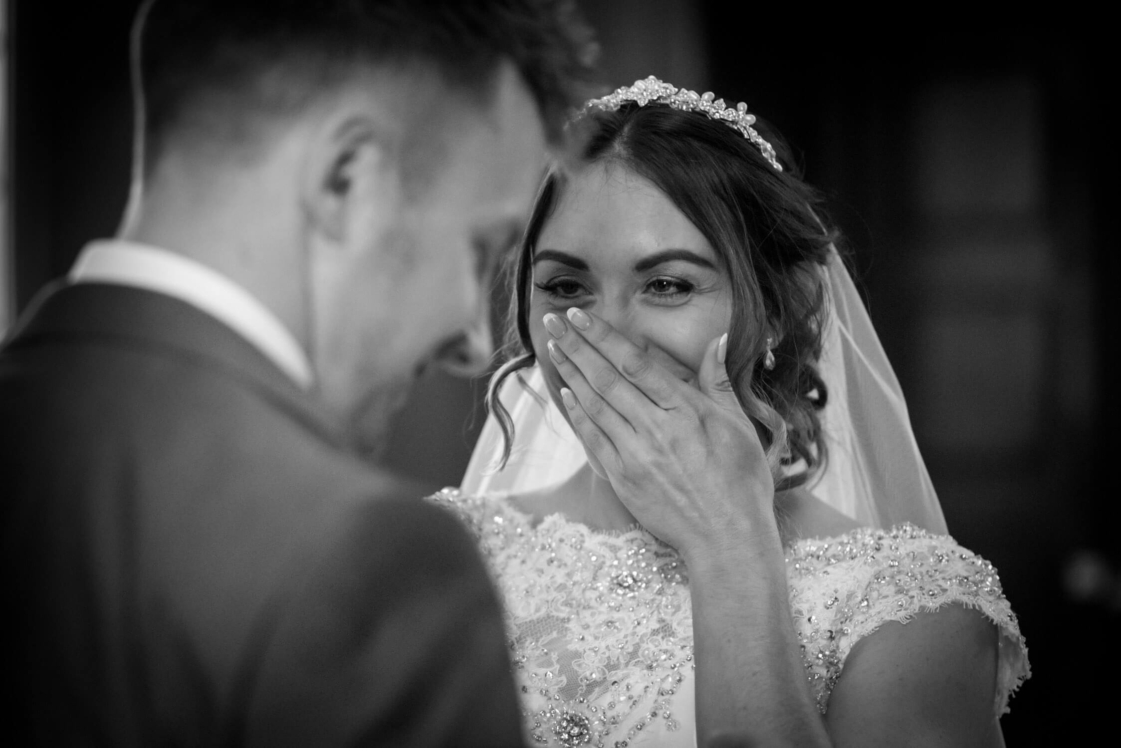 Bride cant help but giggle at Tylney Hall Ceremony