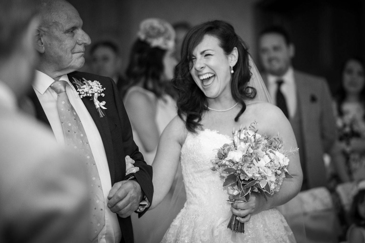 Bride giggles up the aisle at Ashdown Park Hotel