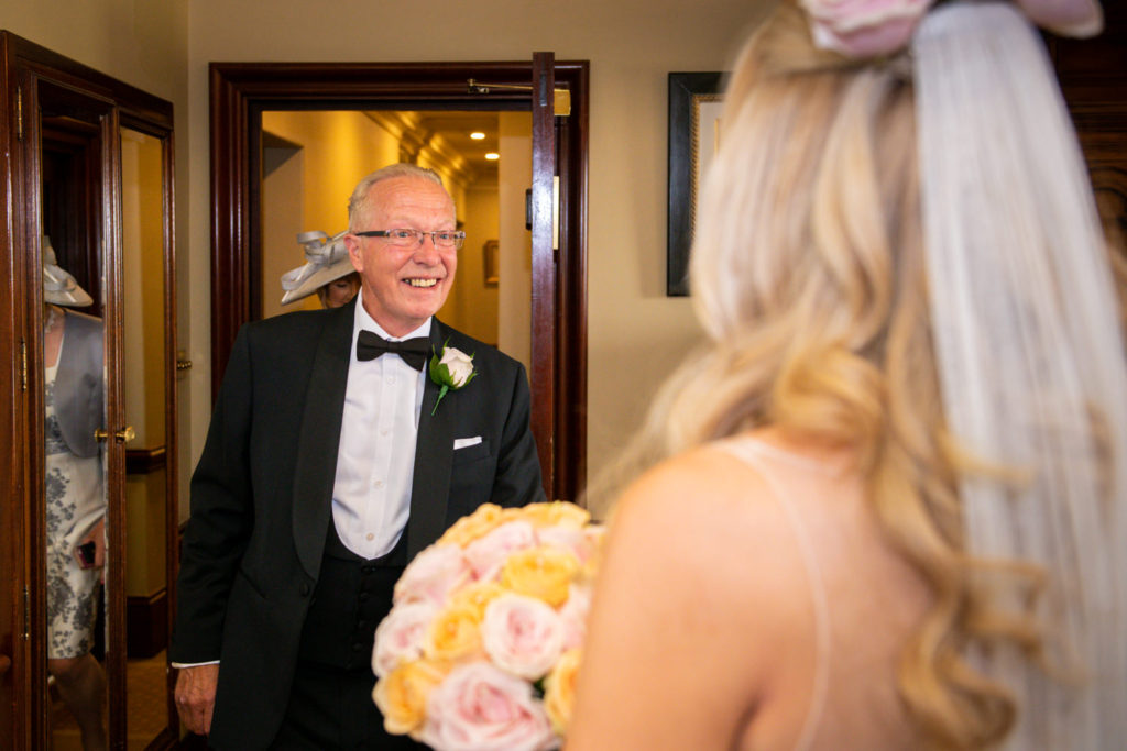 father sees bride for first time on wedding day at Stoke Park Wedding