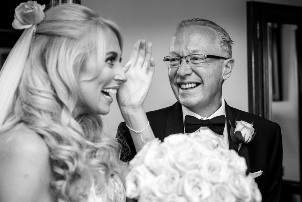 bride and father enjoying a laugh at Stoke Park Wedding
