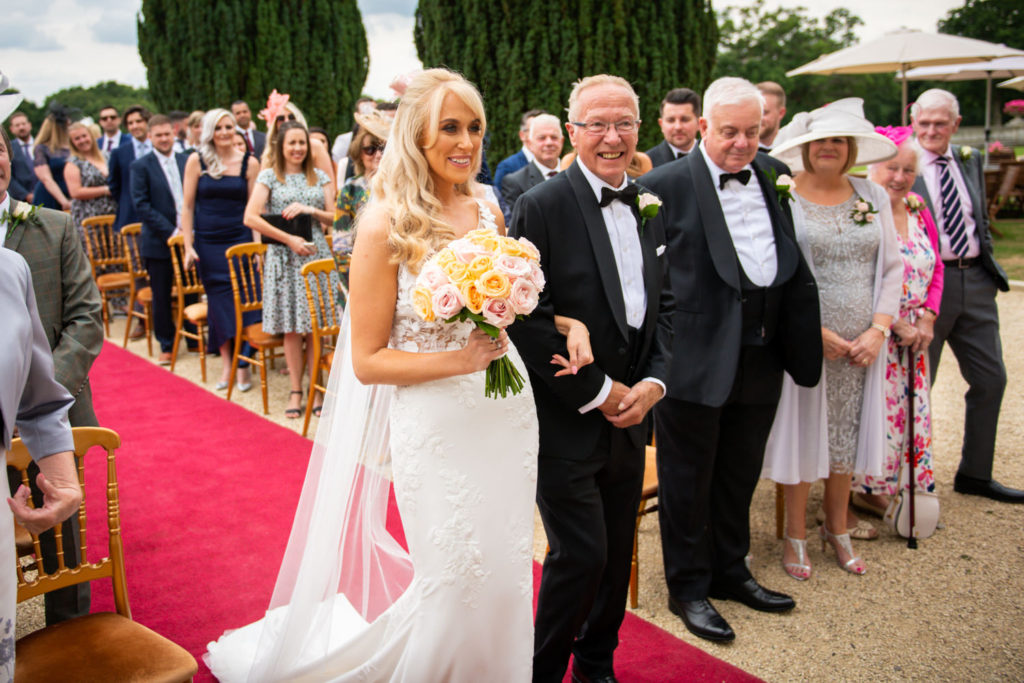 father walks bride down the aisle at Stoke Park Wedding