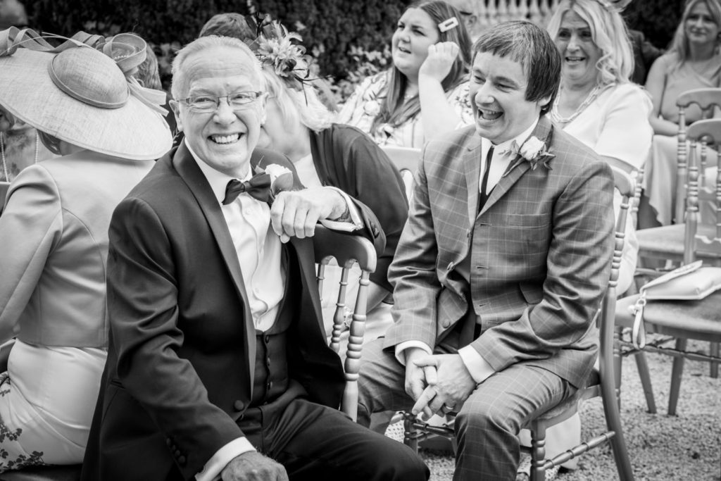 Stoke Park Wedding guests laughing