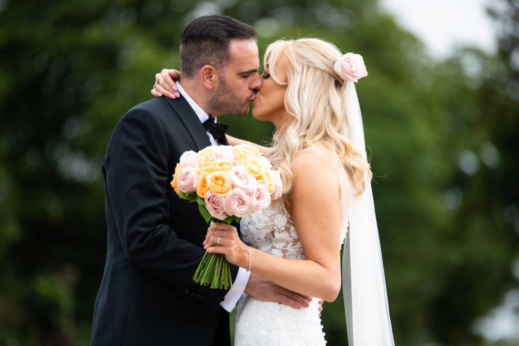Stoke Park Bride and Groom kiss