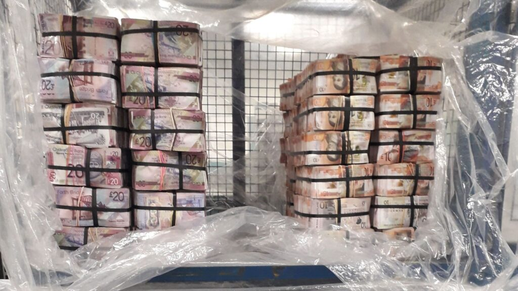 Police in London discovered more than £5m in cash in a flat