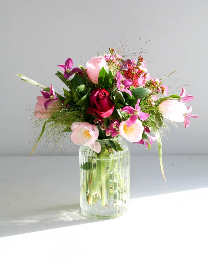 Tulips and clematis arrangement, delivered in North London and created by Garland
