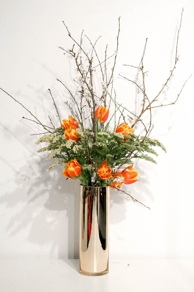 Orange Tulips and twigs for an office reception