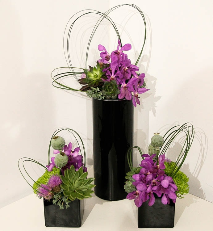 Black vase, purple orchids, contract flowers created by north London florist Garland