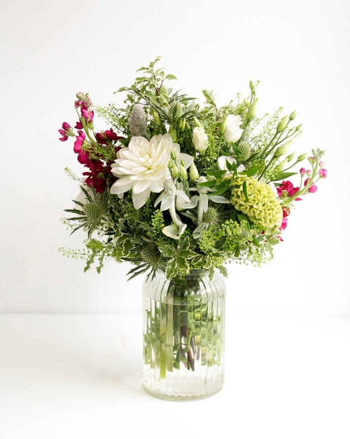 White and Green bouquet with a splash of cerise, by Garland North London florist