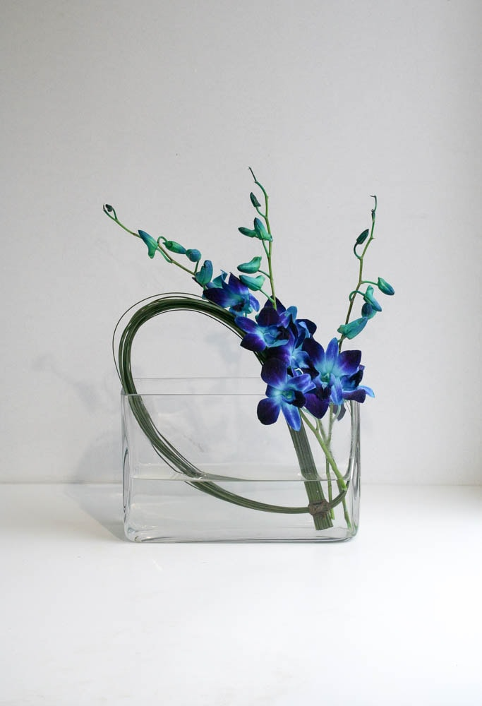 Contract flowers, structurally arranged blue dendrobium orchids, created by north London florist Garland