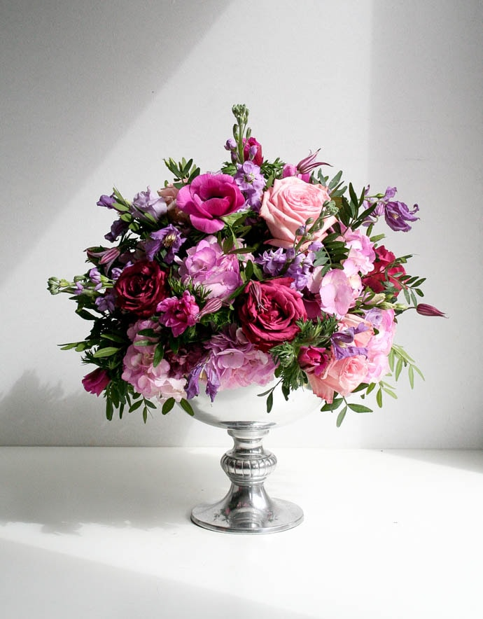 Hot pink, lilac and pink centrepiece created by London florist Garland