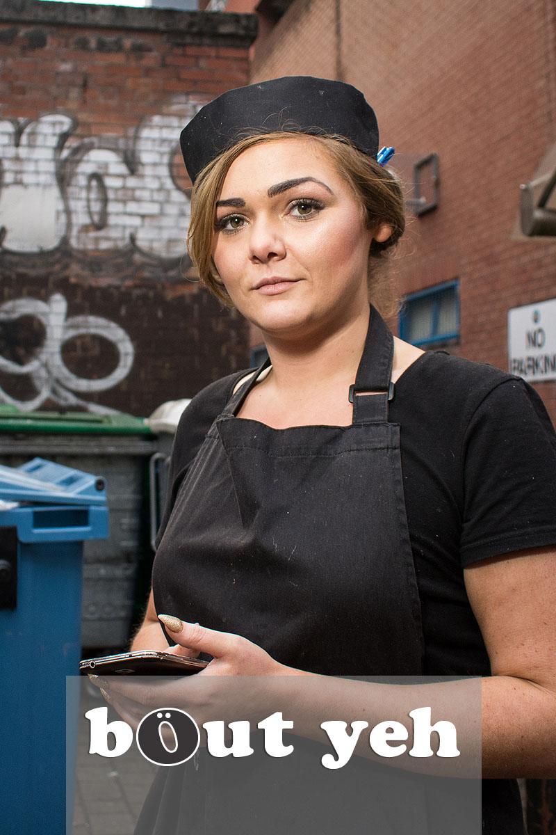 Beautician taking work break outside, in Belfast city centre. Photo 3190.