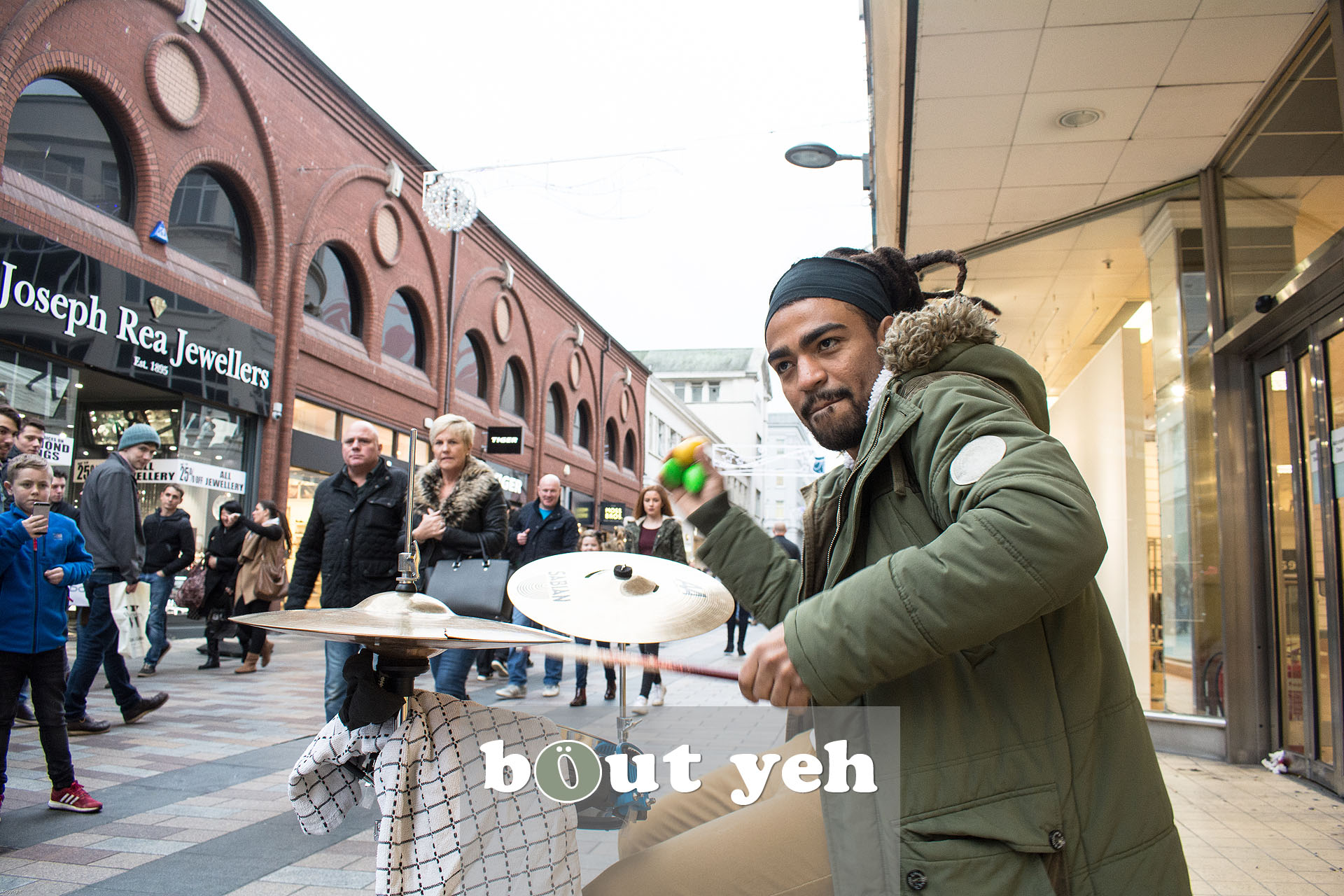 Busker from Brazil drumming in Belfast city centre. Photo 3227.