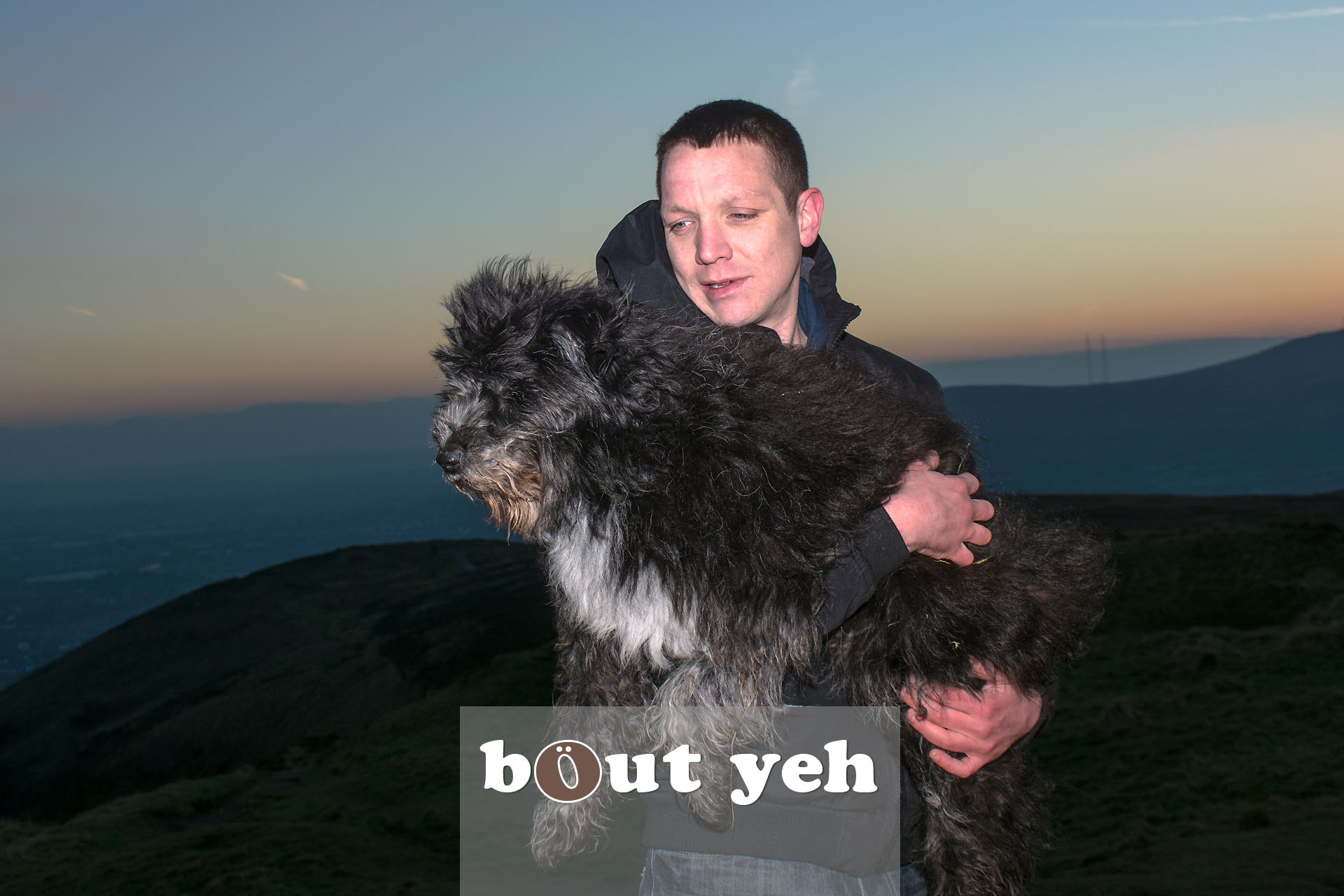 Man carries his dog for last walk on Cave Hill, Belfast, Northern Ireland - photo 4103.