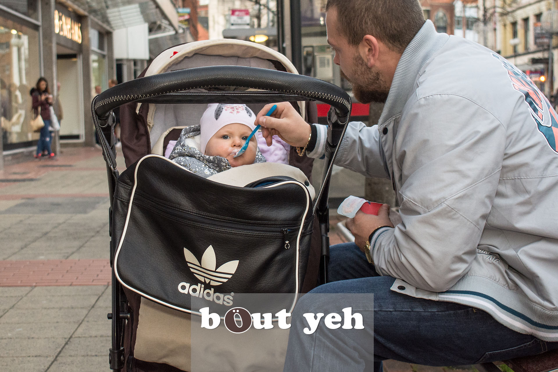 Man feeding baby, Royal Avenue, Belfast - photo 2831.