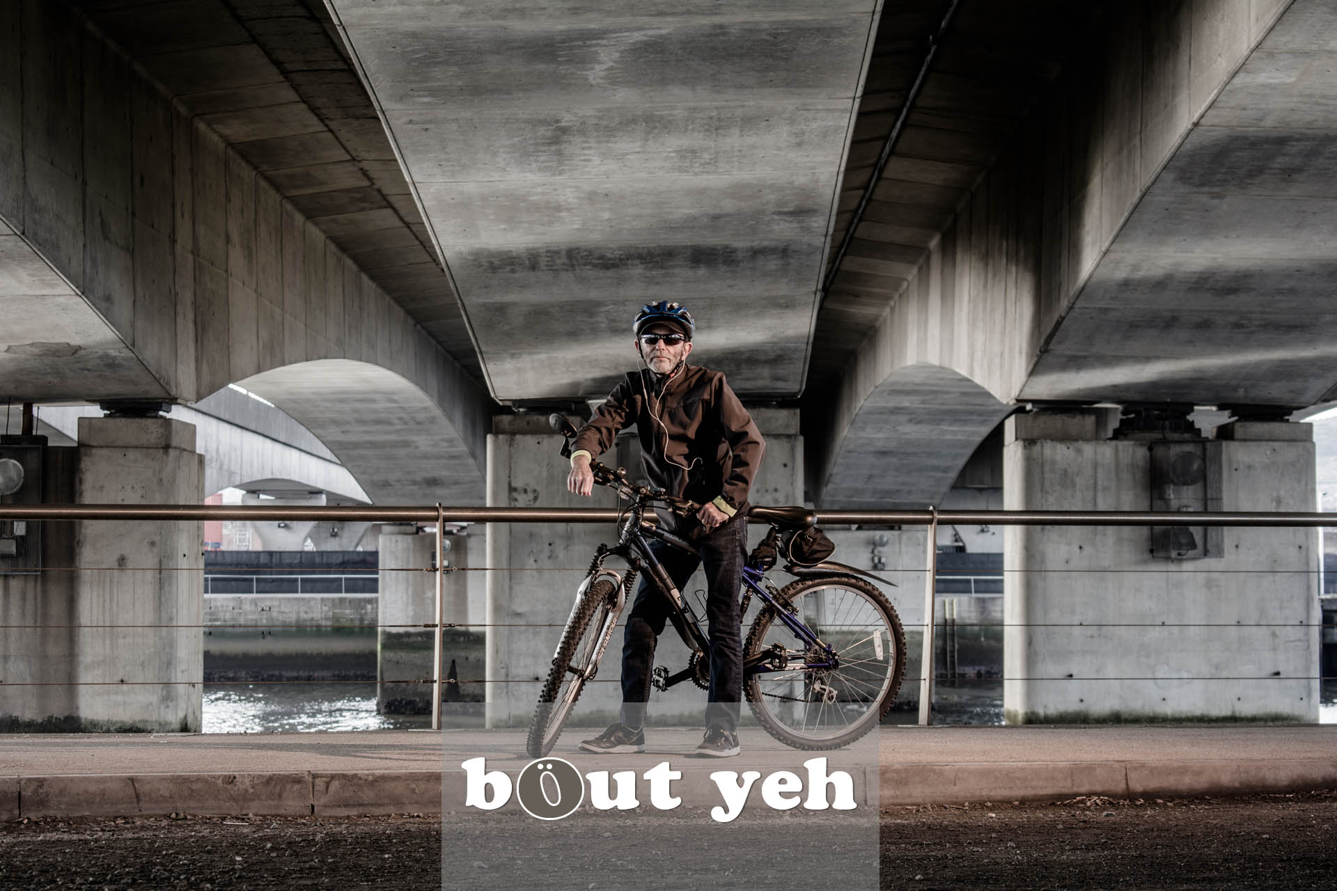 Jerry with bike under Dargan Bridge, Belfast - photo 5041, excluding call to action.