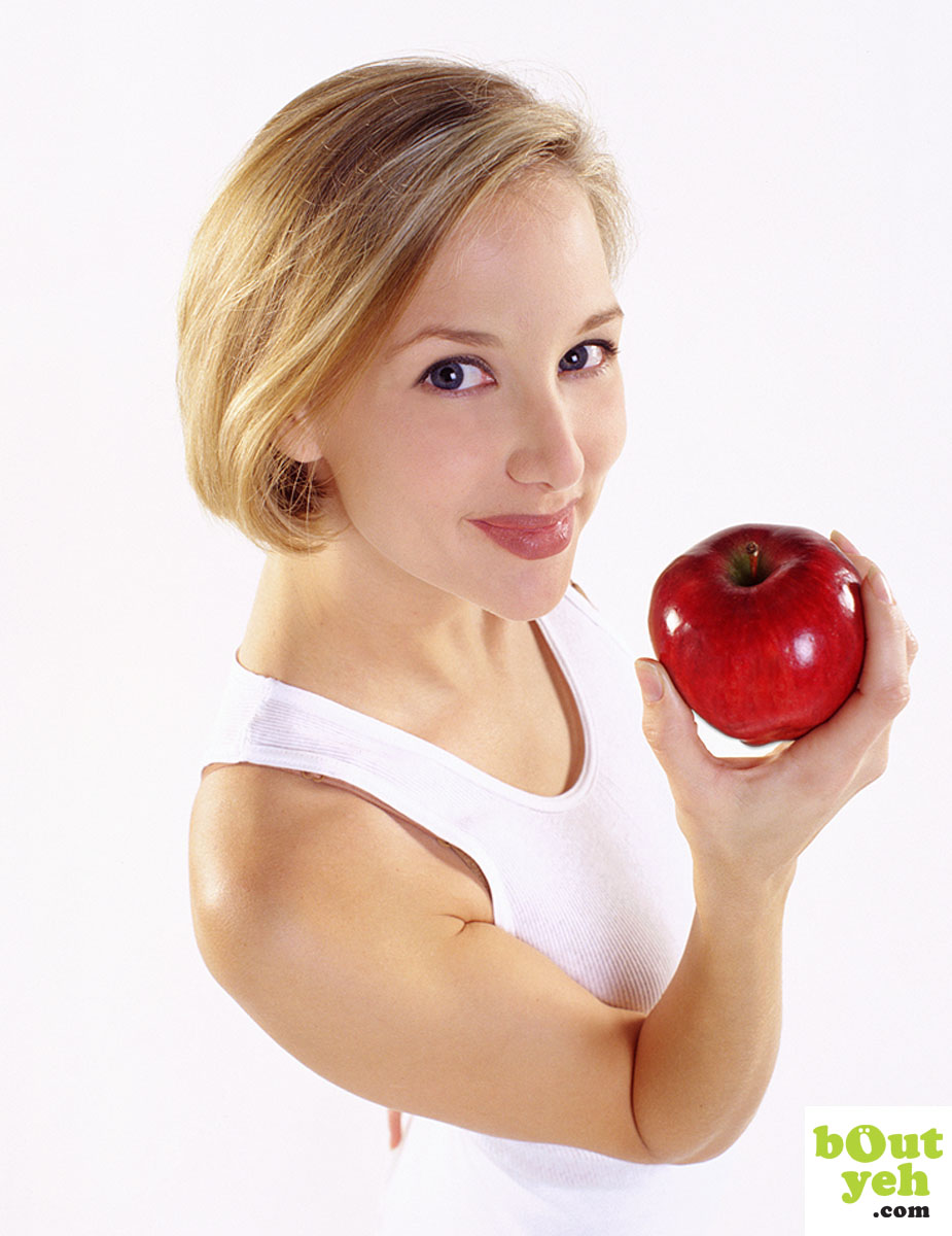 Portfolio portrait photograph of young woman holding red apple.