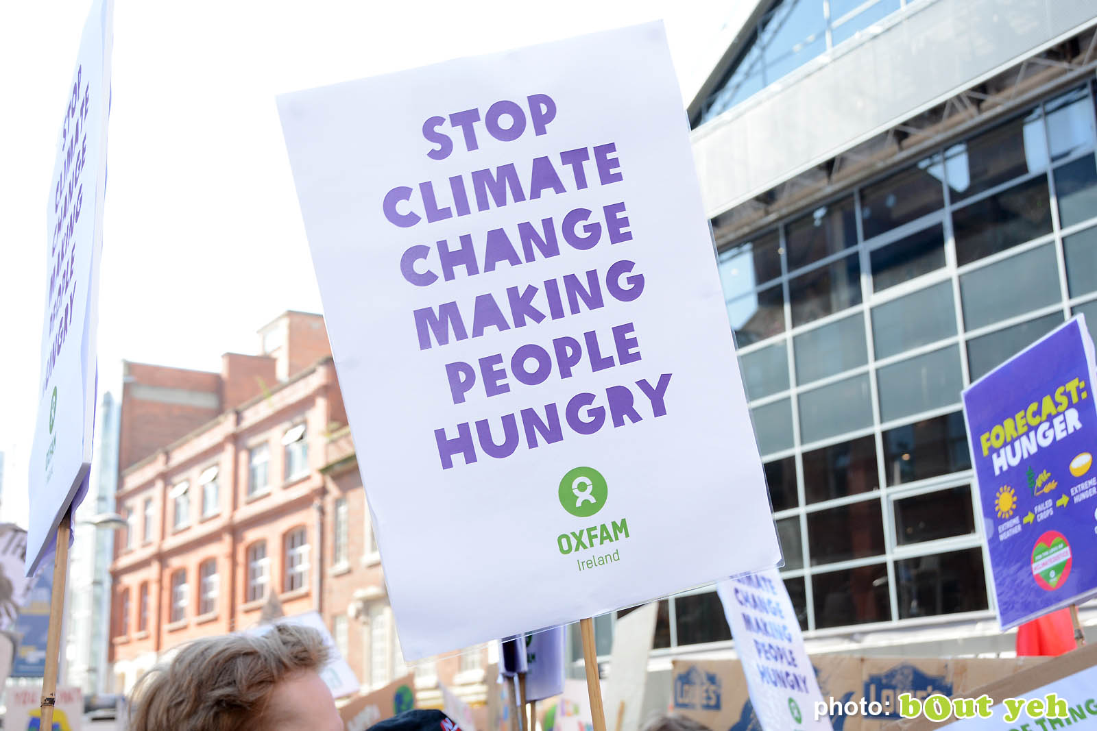 Banner with words stop climate change making people hungry at the strike for climate protest in Belfast. Photo 8937 by Bout Yeh photographers Belfast