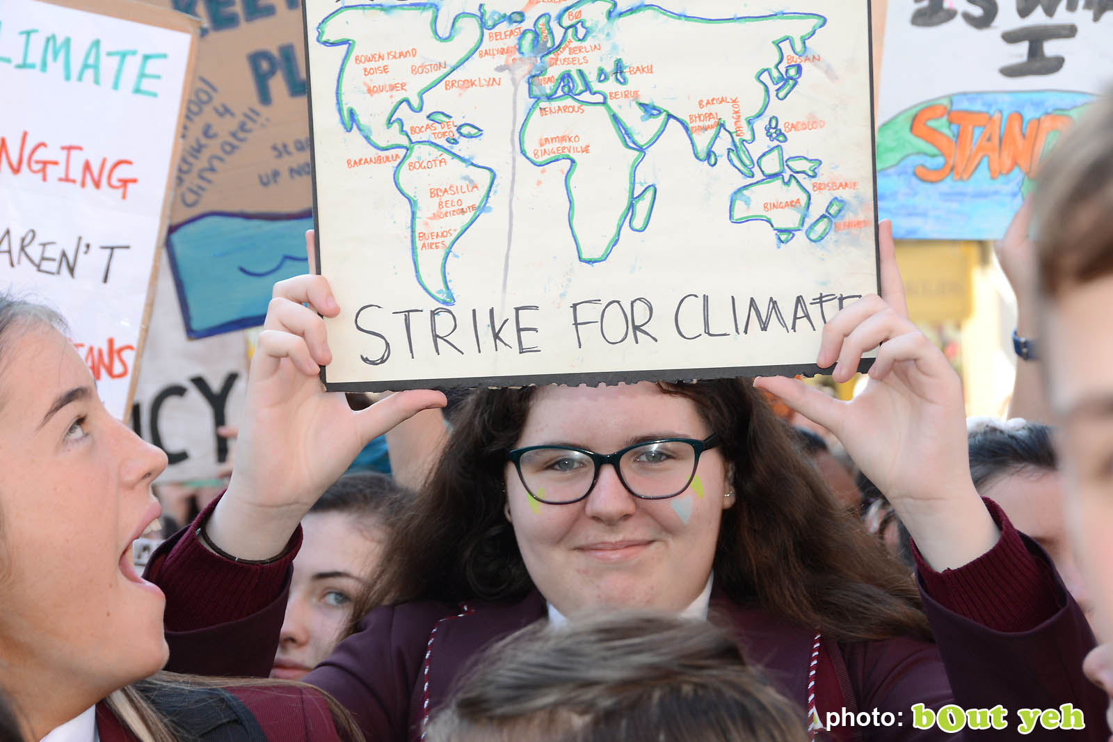 Schoolgirl holding map of the world banner at the strike for climate protest in Belfast. Photo 8943 by Bout Yeh photographers Belfast