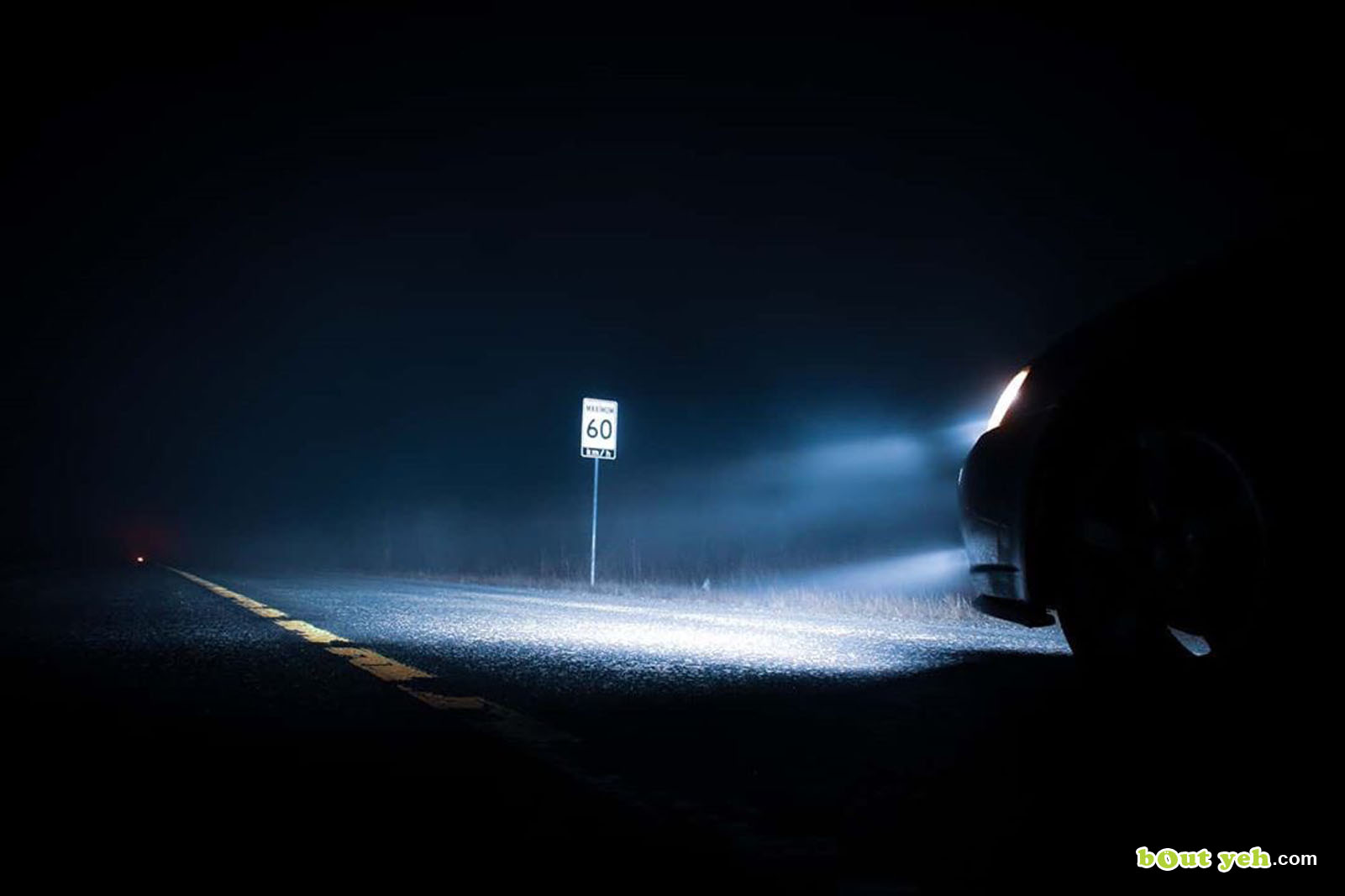 Photograph of road speed sign in car headlights at night by Robert McLaughlin - photo 5895 shared by Bout Yeh photographers Belfast