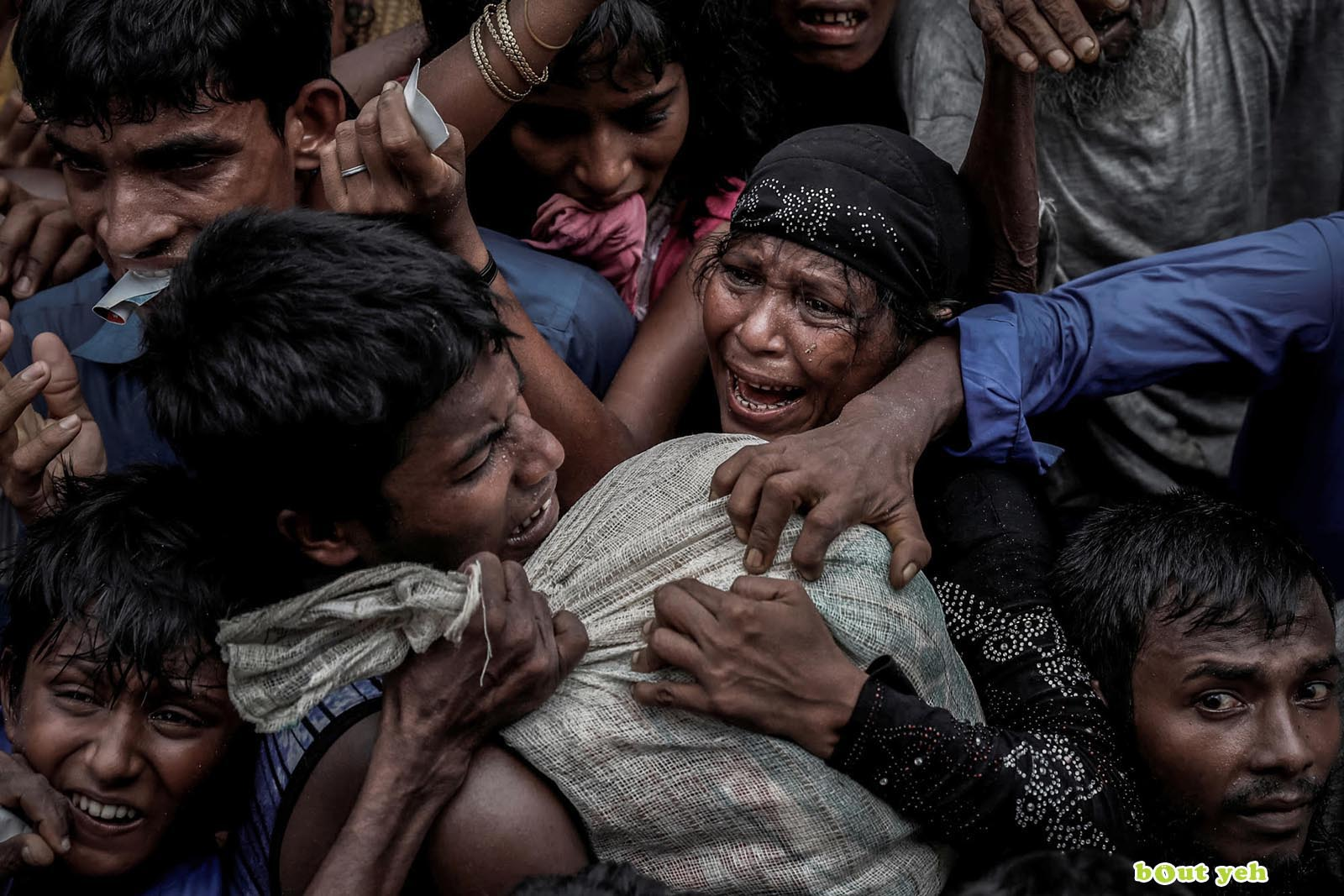 Rohingya refugees scramble for aid at a camp in Cox's Bazar, Bangladesh - photo by Cathal McNaughton shared by Bout Yeh photographers Belfast