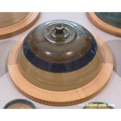 Contemporary Irish homeware ceramics - green, blue and brown cheeseboard bell and board, photo 1773